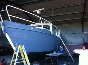 Painting the boat with primer