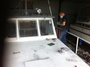 Ben painting the boat